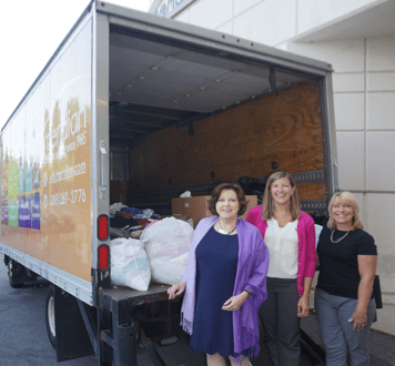 Doing Good, Feels Good. Meridian Personnel pictured above (left to right: Beth Hayes, Senior Director of HR; Kerry Gritzner, HR Intern; Diane Miller, AR/AP Staff) with a Meridian delivery truck full of items collected during the company's 2nd Annual Spring into Summer Clothing Drive, benefiting WGB.